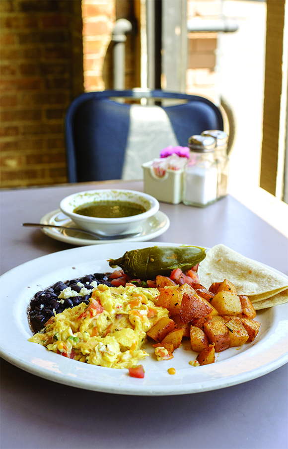The South Austin Migas breakfast plate at AllGood Cafe in Deep Ellum is a hearty way to start the ride.